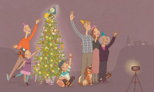 family stand around the christmas tree