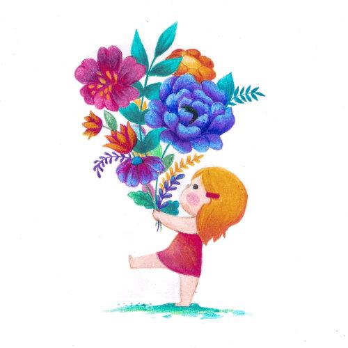 Fille d'enfants avec des fleurs