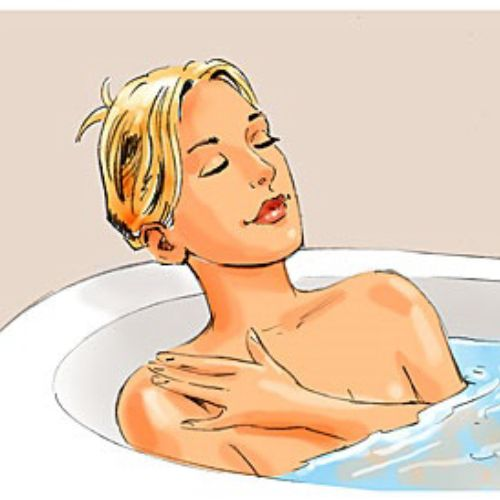 Beautiful woman in bathroom tub