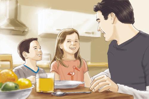 Padre niños en la mesa del comedor
