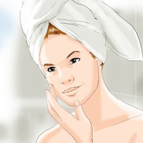 Woman hair wrapped in towel