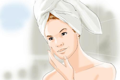 Cabello de mujer envuelto en toalla