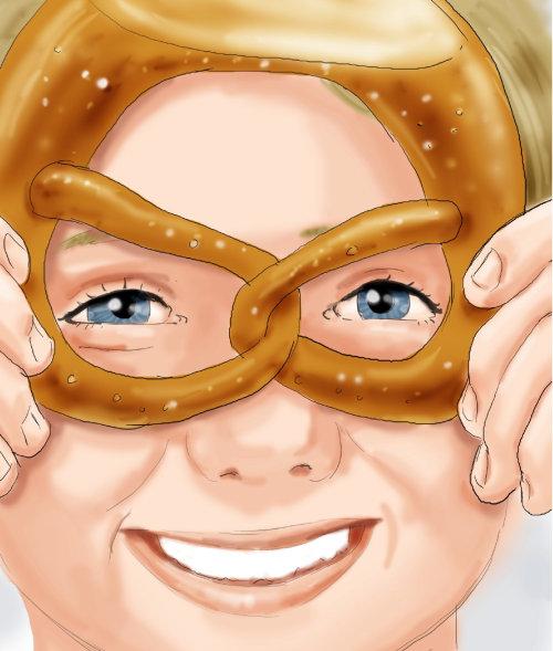 Niño sonriente con pretzel