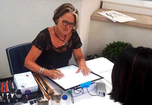 Katharine asher sketching at live event