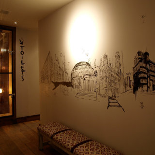Restaurant mural artwork by Ben Tallon