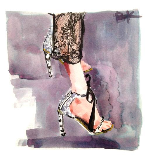 Pernas femininas em sapatos da moda