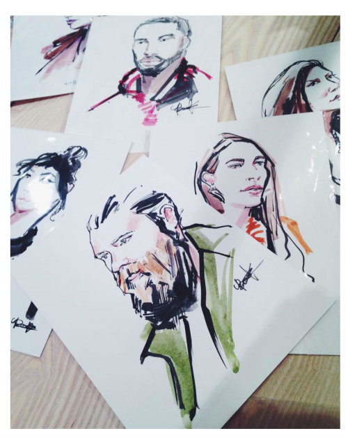 A group of portrait drawings