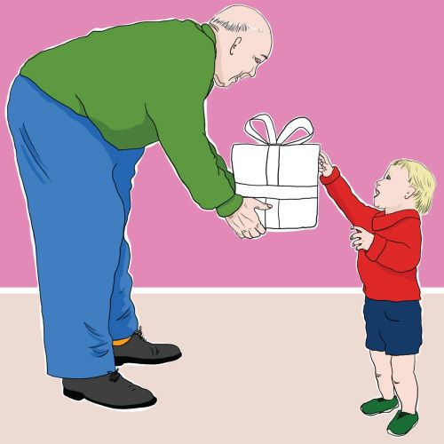 Grandfather presenting gift to grandson