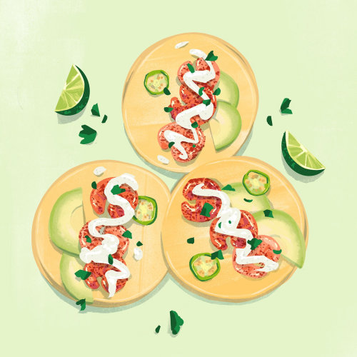Shrimp tacos with crema, jalapenos, lime and cilantro.