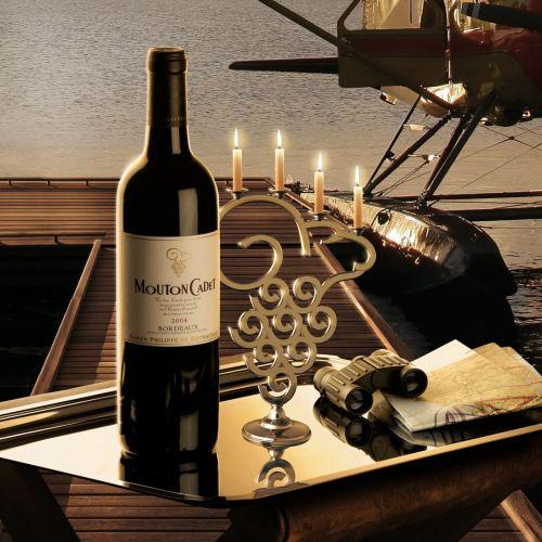 Wine bottle near lake deck