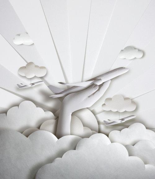 Avión en el arte de papel cortado a mano