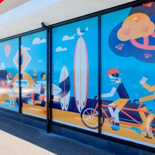 Beach illustration on showroom mirror