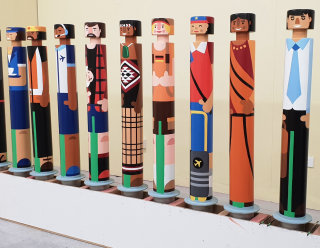 Airlines staff painting on bollard by Greg Straight