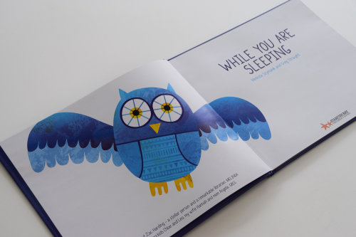 Digital owl on book