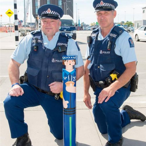 Police officers with painted bollard