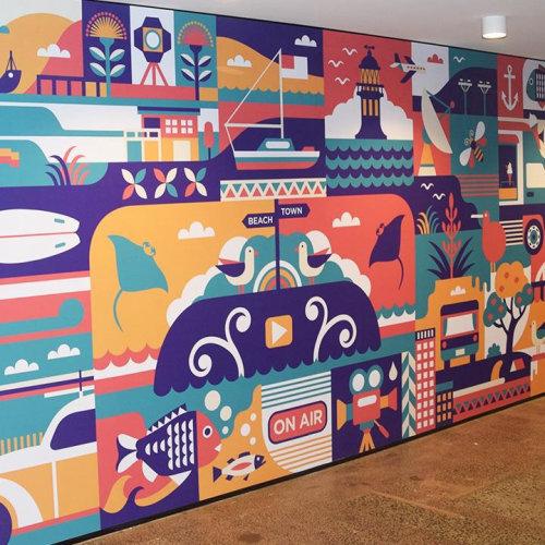 Arte de praia e cidade na parede