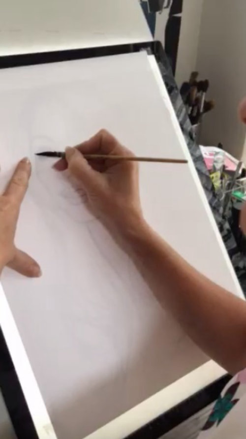 Live event drawing of a fashion model