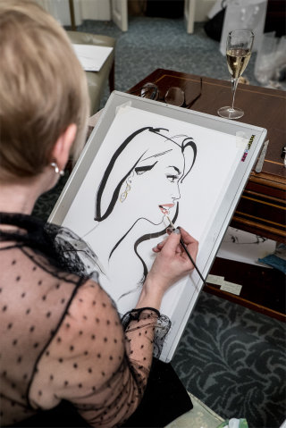 Live drawing of lady by Jacqueline Bissett