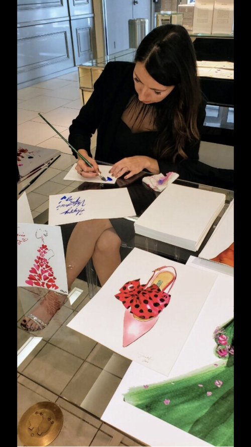 Live event drawing artist at the desk