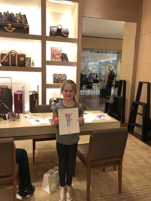 Live event drawing of girl with her art