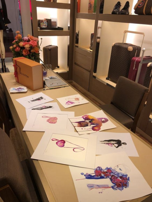 Live event drawing of various art on table