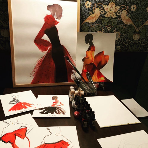 Live event drawing of woman in red dress