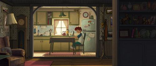 男孩坐在郊区厨房餐桌上的傻瓜电影的视觉艺术