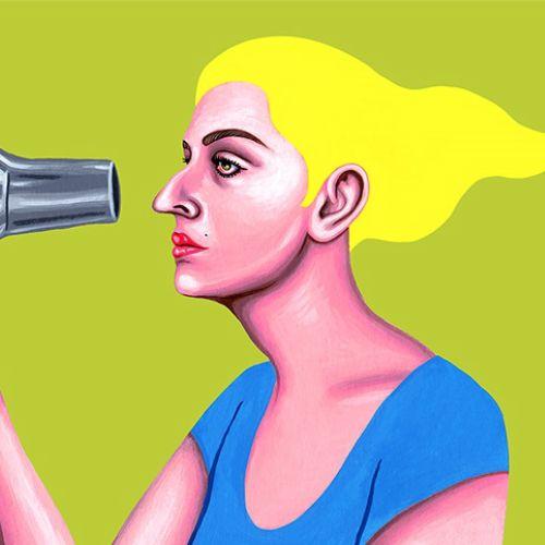 Beautiful girl using hair dryer
