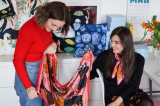 Karen Mabon displaying her scarf to a buyer