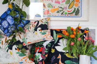 Pile of cushions designed by Karen Mabon