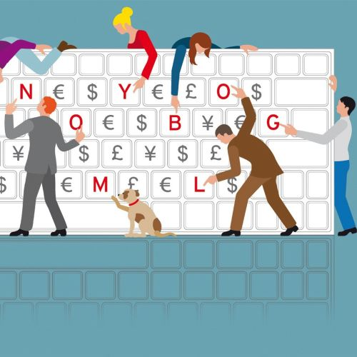 People and a dog showing computer keyboard letters