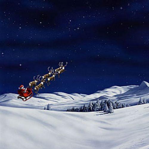 Santa flying on a winter landscape