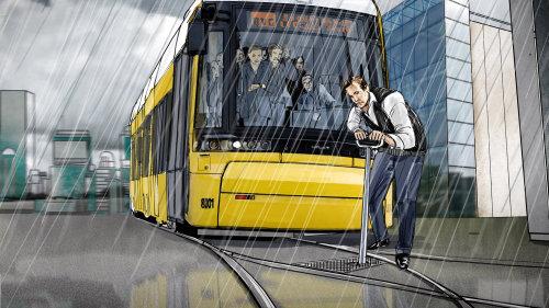 男子在雨天修理电车线