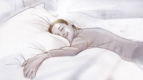 睡觉在床上的愉快的妇女