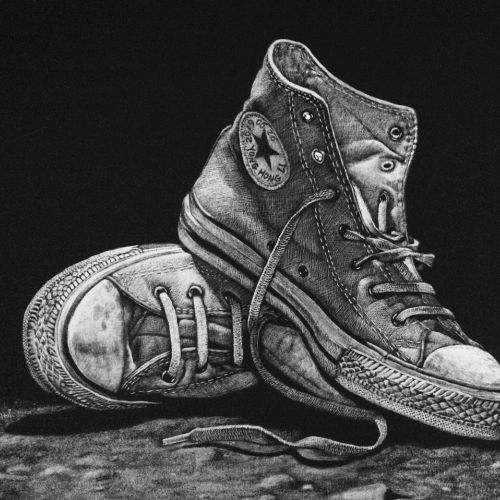 Black and white drawing of sneakers shoes