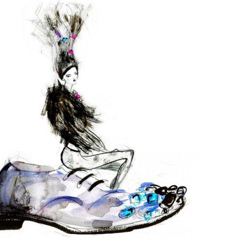 Jewellery model sitting on fancy shoe