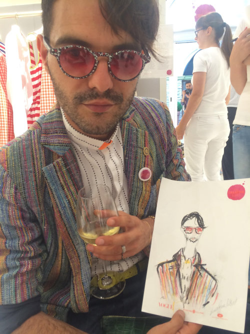live event drawing of man with his art
