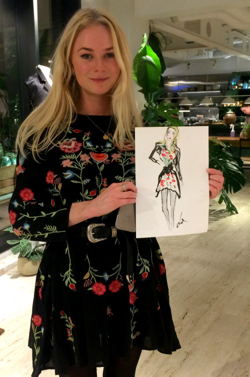 Live event drawing womain with black floral dress