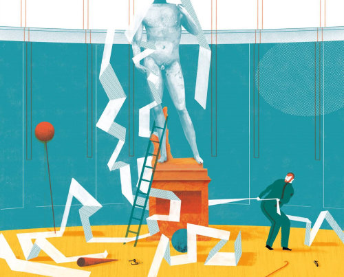 a sculpture surrounded by papers and a man pulling out the papers