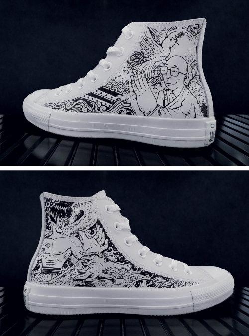 Black and white art of Dalai Lama on white shoe
