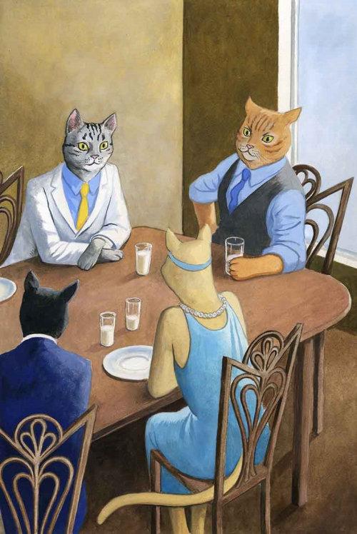 Les gens de chat appréciant le lait