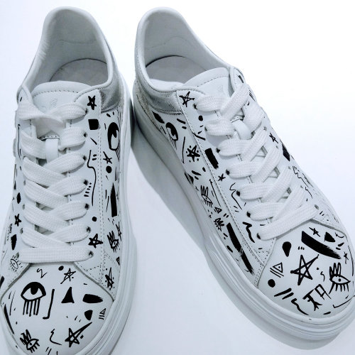 Black and White art on white shoes