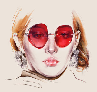 Portrait of a stylish lady with red glasses