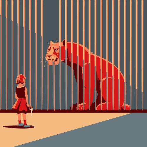 孩子在动物园里看着老虎
