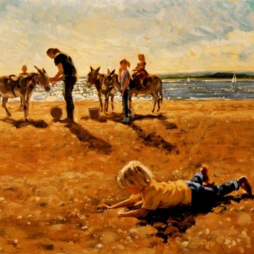 Family with donkeys at beach