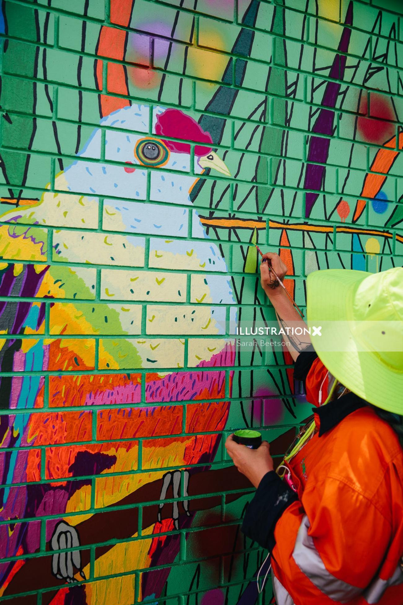 Hand painted bird wall mural