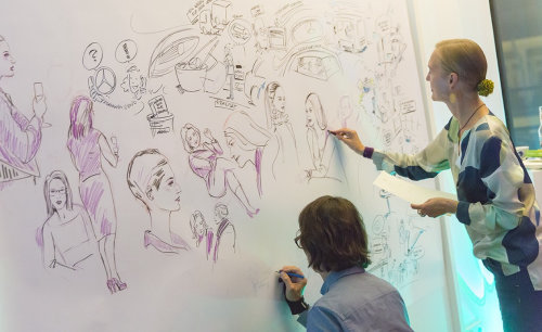 Live drawing of women on wall