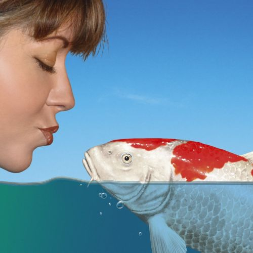 woman kissing koi fish