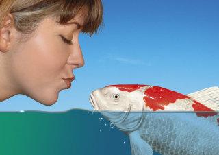 woman kissing koi fish