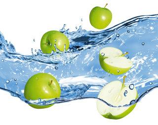 Green Apples in water splash